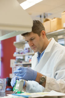 Dan Frigo in lab 2014 portrait