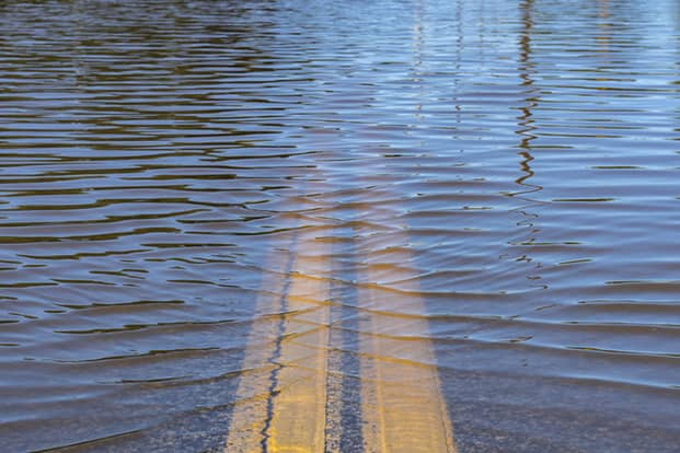 Water floods a road.