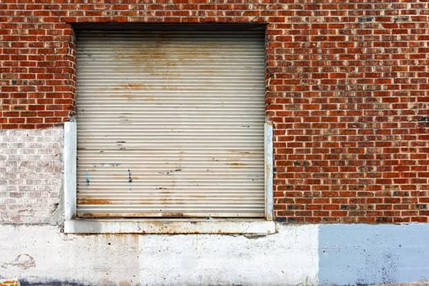 A warehouse garage in a brick building.