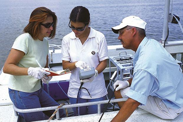 UH Professor Hanadi Rafai and team on a boat analyzing samples.